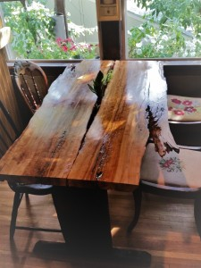 Front view of live-edge cherry table with plants