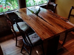 view of live-edge cherry table with plants