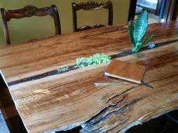 Above view of live-edge cherry oak table with plants