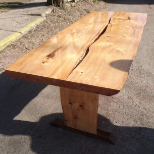 Front view of live-edge white spruce garden table