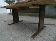 Beneath the live-edge white oak table with amethyst stones