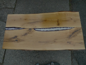 Above view of live-edge white oak table with amethyst stones