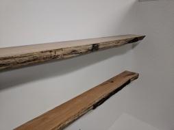 Custom live-edge shelves viewed from the left side