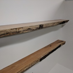 Custom live-edge shelves viewed from the left side