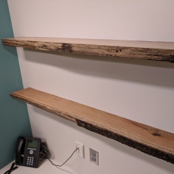 Custom live-edge shelves viewed from the right