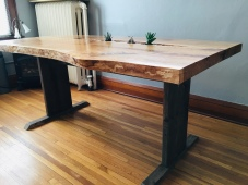 Beneath view of live-edge cherry table with succulent plants