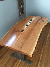 Above view of live-edge cherry table with succulent plants