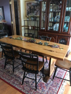 Side view of live-edge spruce table with succulent plants