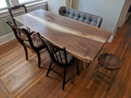 Live-edge walnut pearl epoxy table with chairs